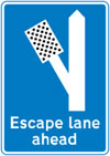 Escape lane to left for vehicles unable to stop on a steep hill